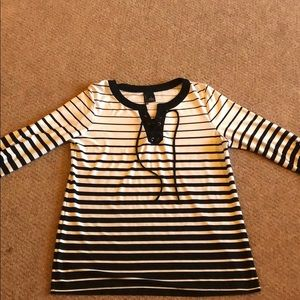 Women's black and white top.